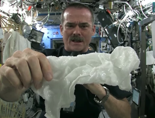 Teaching What happens when you wring a wet washcloth in space? [video]