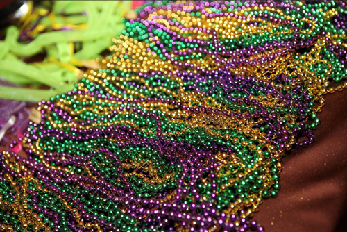 Teaching The destructive life of a Mardi Gras bead