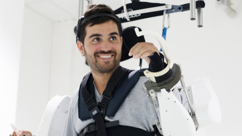 Teaching Paralyzed man moves in mind-reading exoskeleton