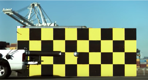 What happens when a soccer ball is fired from a moving truck? [video]